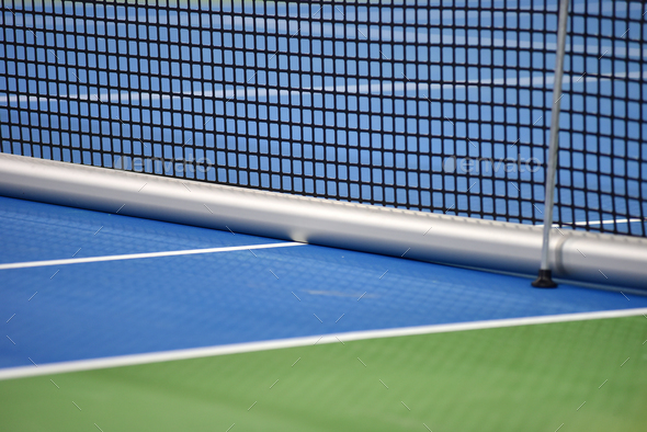 Tennis blue hard court with net before competition - Stock Photo - Images