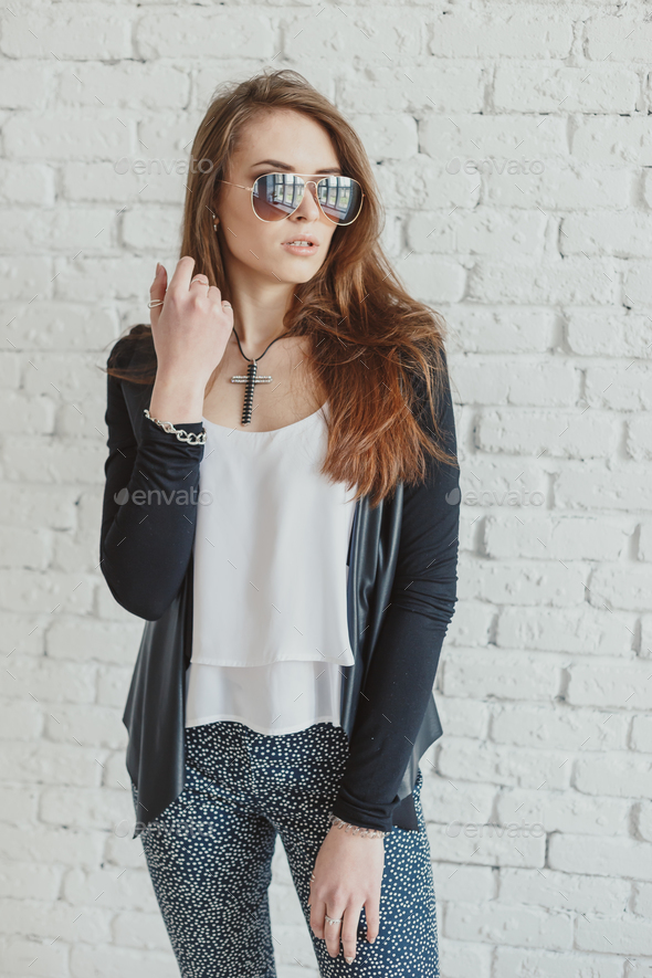 Young pretty woman outdoor fashion portrait. Beautiful girl wearing sunglasses - Stock Photo - Images