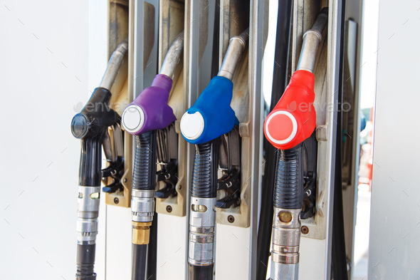 Fuel nozzle dispensing pump at gas station. The fuel for transportation concept. - Stock Photo - Images