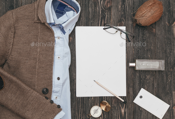 Squared flat lay of mens casual clothes on black wooden background. Top view - Stock Photo - Images