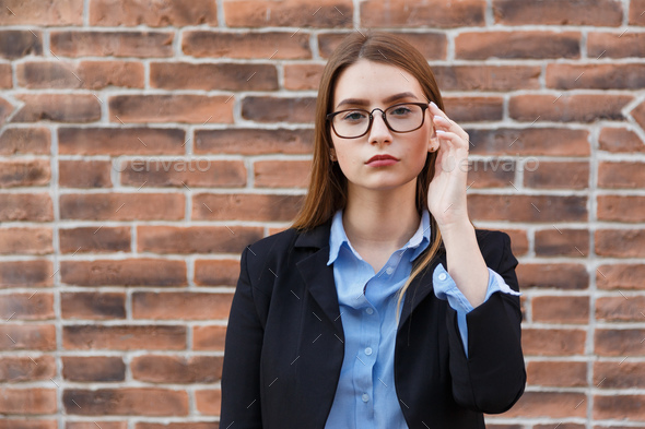 Portrait of beautiful student girl wearing glasses - Stock Photo - Images