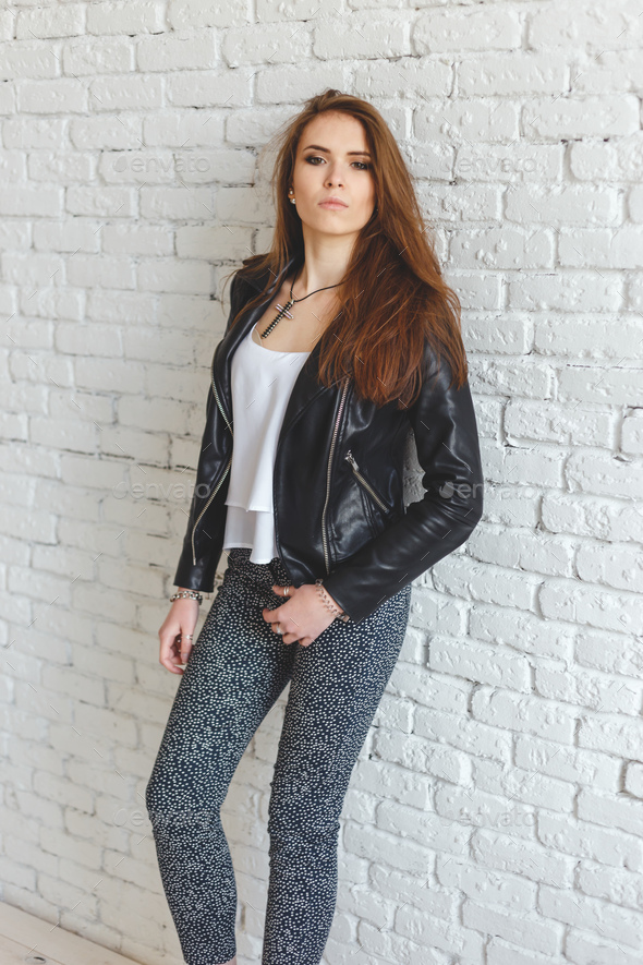 Portrait of sexy beautiful young brunette woman in leather jacket - Stock Photo - Images