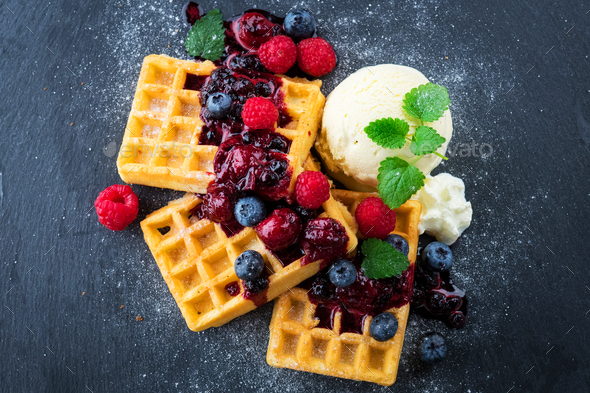 Waffles with ice cream and hot fruits sauce - Stock Photo - Images