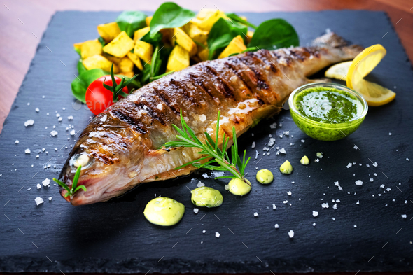 Grilled trout with potato and spinach - Stock Photo - Images