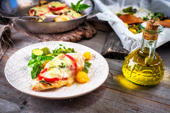 Chicken breast stuffed with mozzarella; basil and tomatoes - Stock Photo - Images