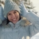 Happy Young Woman Posing for the Camera in the Suburbs in Winter - VideoHive Item for Sale