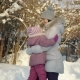 Happy Mom and Daughter Hug and Play in the Suburbs in Winter. - VideoHive Item for Sale