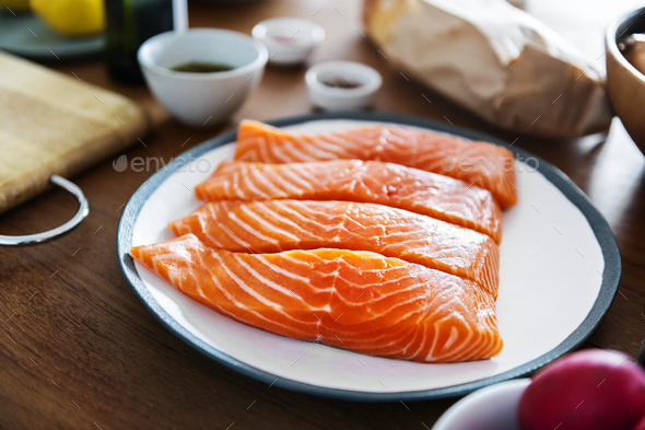 Raw salmon preparing to be cooked - Stock Photo - Images