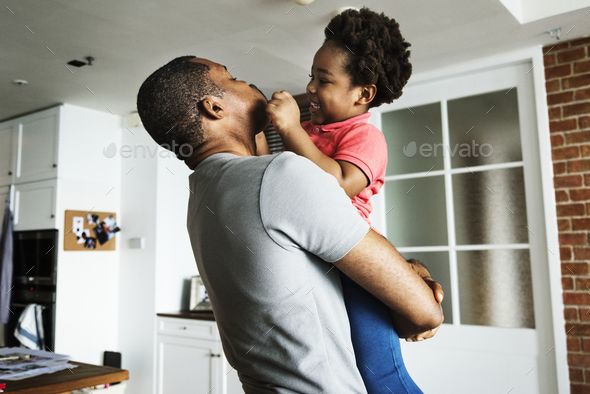 Dad and son spending time together - Stock Photo - Images
