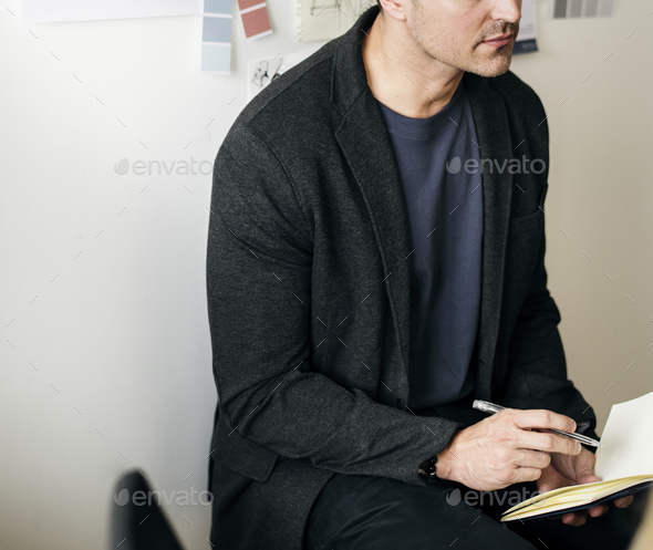 Caucasian man taking a note - Stock Photo - Images