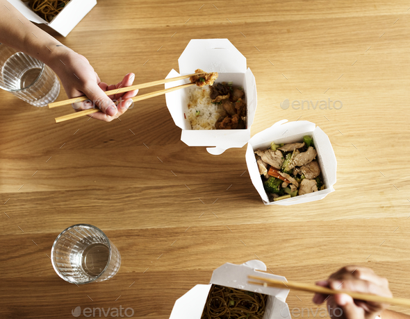 Friends eating Chow mein together - Stock Photo - Images