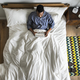 Man in bed using a digital device - PhotoDune Item for Sale
