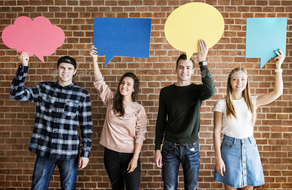 Friends holding up copyspace placard thought bubbles - Stock Photo - Images