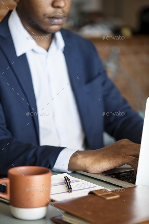 Black businessman using computer laptop - Stock Photo - Images