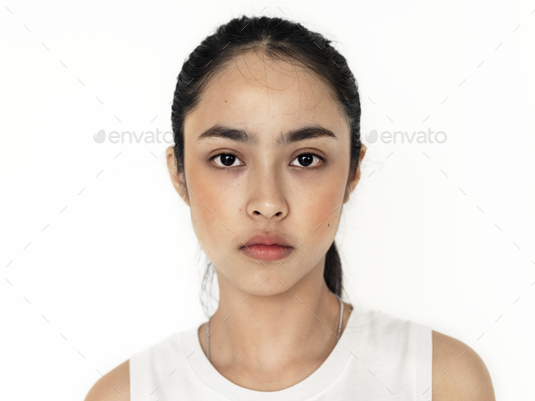 Young Asian girl portrait isolated - Stock Photo - Images