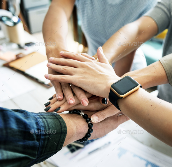 Hands stacking support each other - Stock Photo - Images
