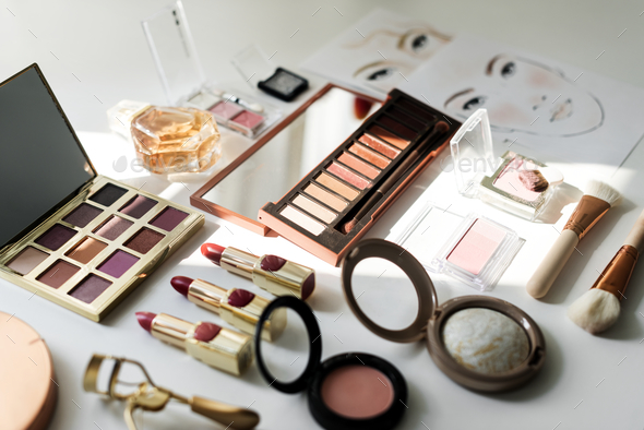 Various makeup products on white table - Stock Photo - Images
