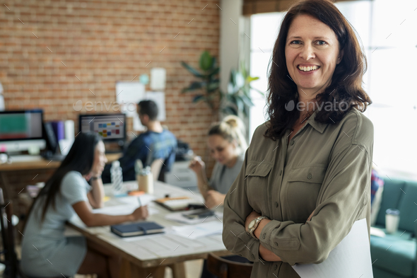 Portrait of Caucasian woman at office - Stock Photo - Images