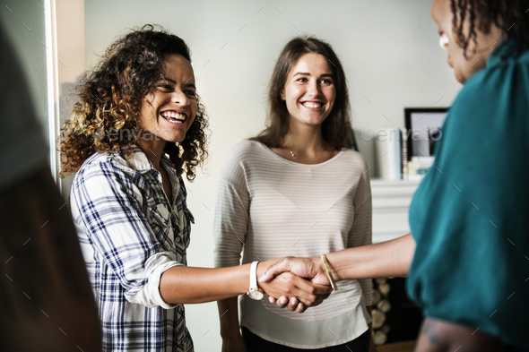 Diverse woman shaking hands - Stock Photo - Images