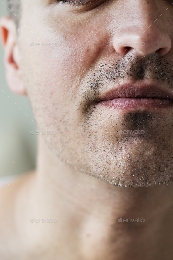 Portrait of white man closeup on mouth - Stock Photo - Images