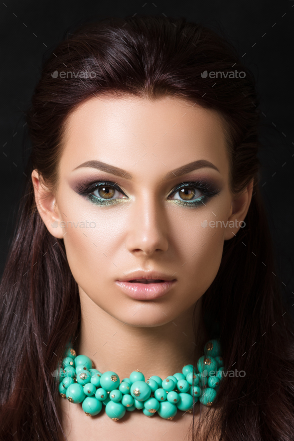 Close-up beauty portrait of young pretty brunette - Stock Photo - Images