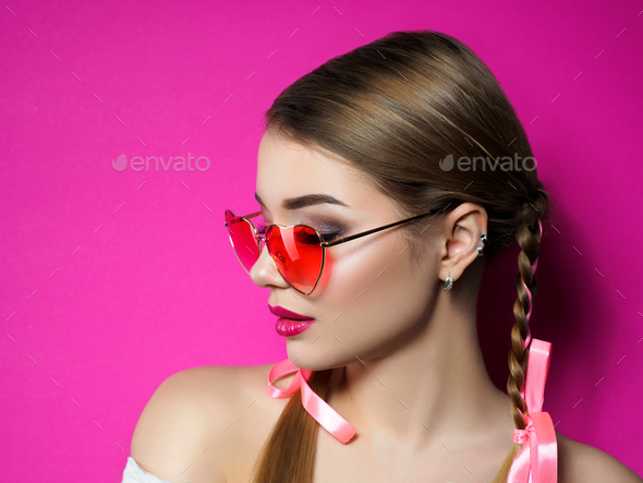 Young woman wearing heart shaped glasses - Stock Photo - Images