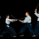 Man and woman fighting at Aikido training in martial arts school - PhotoDune Item for Sale