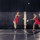 Young women playing badminton at gym - PhotoDune Item for Sale