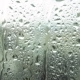 Drops of Rain on a Window Pane, Buildings in Background - VideoHive Item for Sale