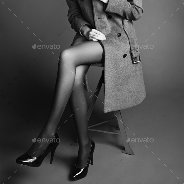 Young woman in coat with beautiful feet - Stock Photo - Images