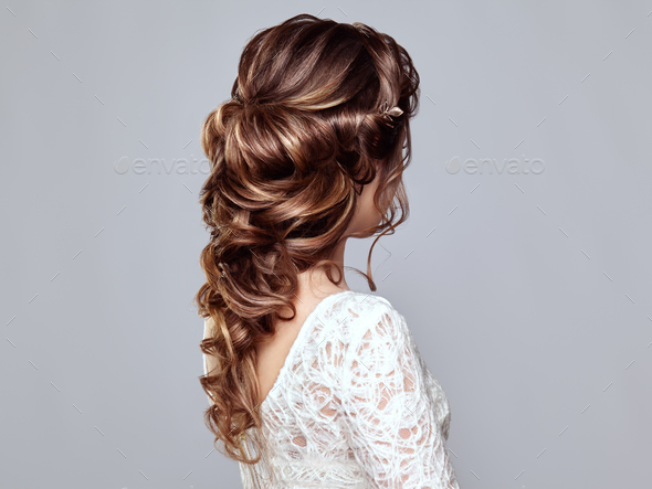 Brunette woman with long and shiny curly hair - Stock Photo - Images