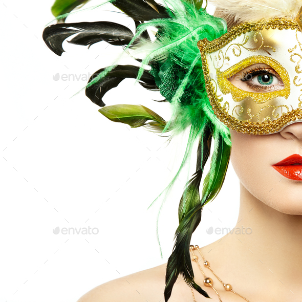 Beautiful young woman in mysterious golden Venetian mask - Stock Photo - Images