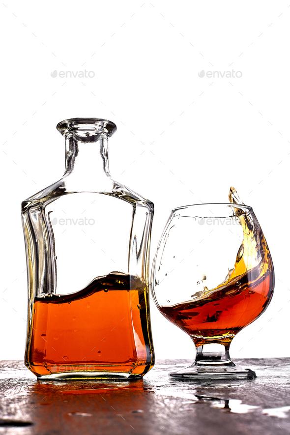 Glass of splash whiskey with bottle. - Stock Photo - Images