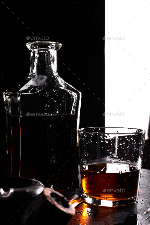 Glass of whiskey with smoking cigar. - Stock Photo - Images