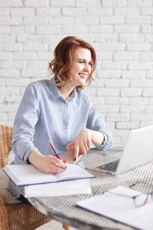 Modern happy business woman in the office - Stock Photo - Images