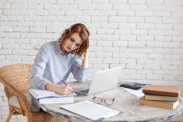 Woman freelancer female hands with pen writing on notebook at home or office - Stock Photo - Images