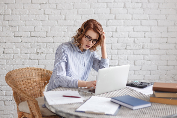 The business woman very serious in front of her laptop in the office. - Stock Photo - Images