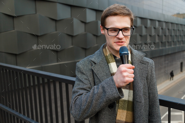 Professional news reporter outdoor - Stock Photo - Images