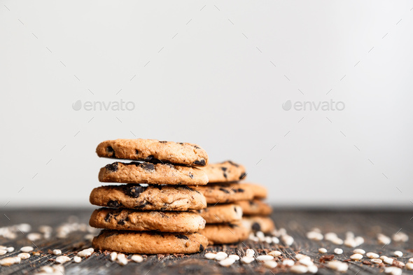 Stacks of chocolate chip cookies on dark table with copy space on top - Stock Photo - Images