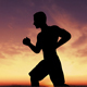 Silhouette Of Man Jogging In The Country - VideoHive Item for Sale