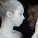 Girl in a White Makeup Gently Holds the Face of a Black Man - VideoHive Item for Sale