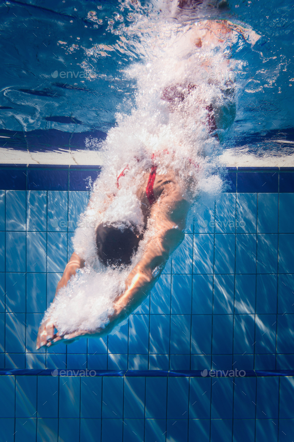 Diving in to the pool - Stock Photo - Images