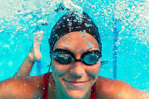 Female swimmer underwater - Stock Photo - Images