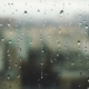 Drops of Rain on a Window Pane with Buildings in Background - VideoHive Item for Sale