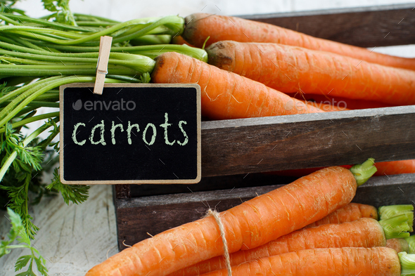Fresh raw carrots with leaves in a box - Stock Photo - Images