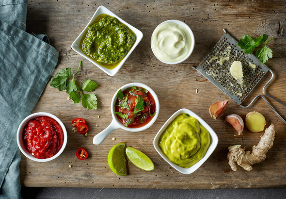 various sauces on wooden table - Stock Photo - Images