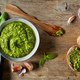 Bowl of basil pesto on wooden table - PhotoDune Item for Sale
