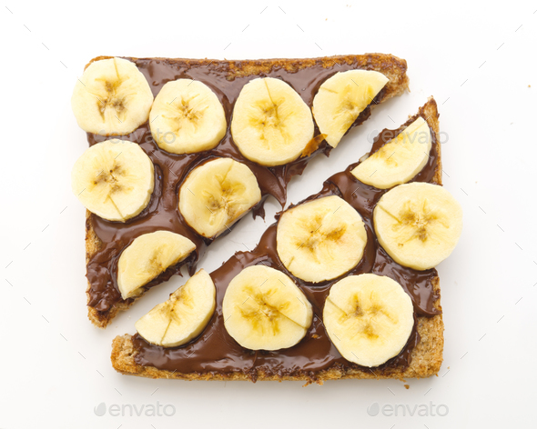 overhead shot of chocolate toast with cut banana, isolated on white - Stock Photo - Images