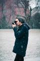 Young photographer using mirrorless camera - PhotoDune Item for Sale