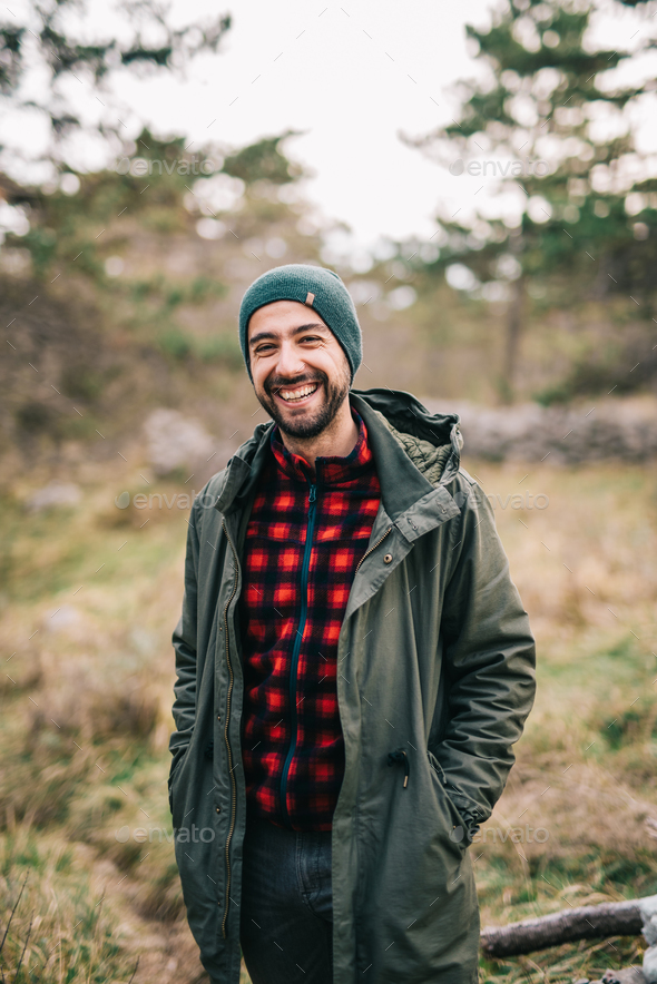 Man in nature smiling - Stock Photo - Images
